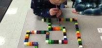 Kindergarteners in Mrs. Pace's class create wind-powered mazes for STEM week.